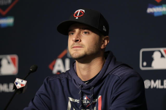 FILE - In this Saturday, Oct. 5, 2019, file photo, Minnesota Twins starting pitcher Jake Odorizzi talks to reporters during a baseball news conference at Yankee Stadium in New York. Odorizzi accepted Minnesotas one-year qualifying offer to put him under contract for 2020, after his first career All-Star game appearance. (AP Photo/Seth Wenig, File)
