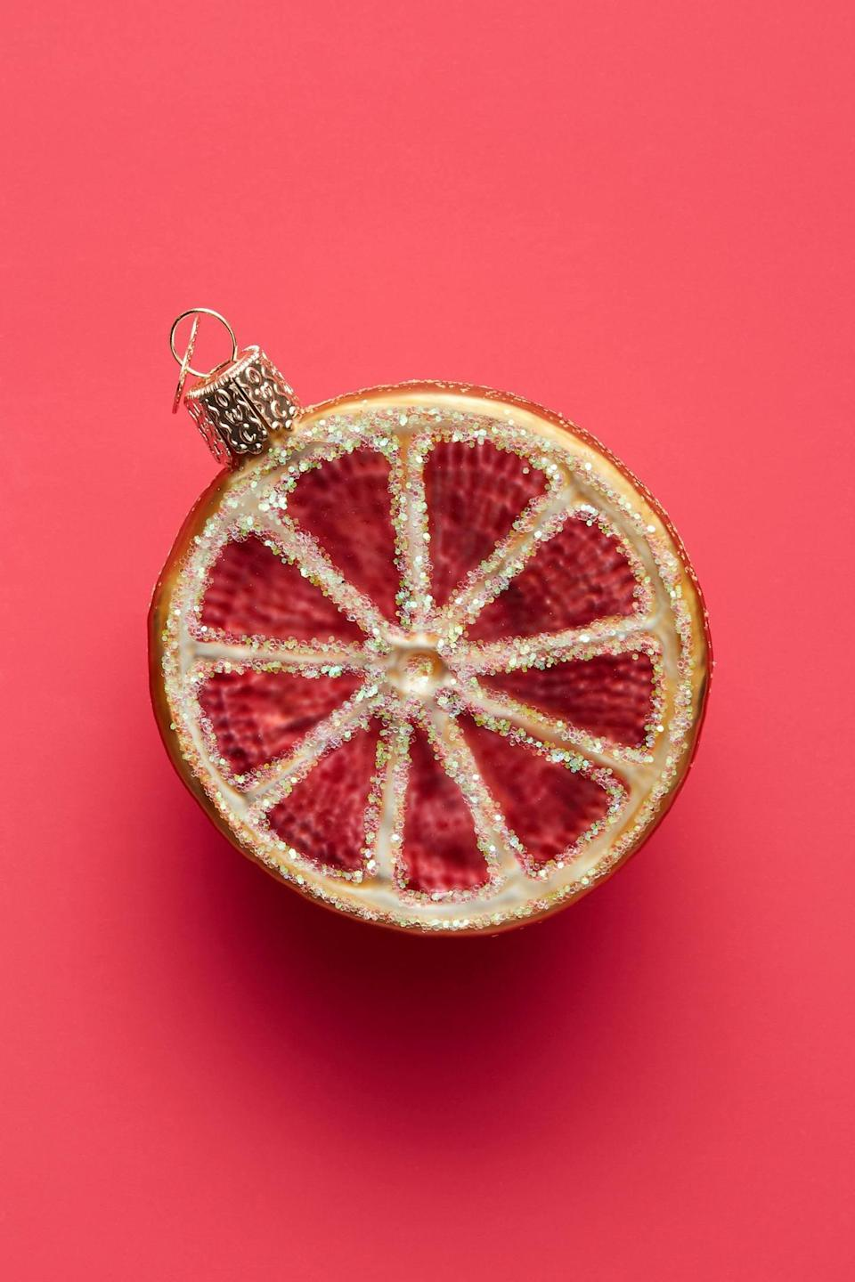 """<p>The <a href=""""https://www.popsugar.com/buy/Sliced-Grapefruit-Ornament-490503?p_name=Sliced%20Grapefruit%20Ornament&retailer=anthropologie.com&pid=490503&price=16&evar1=casa%3Aus&evar9=46615300&evar98=https%3A%2F%2Fwww.popsugar.com%2Fhome%2Fphoto-gallery%2F46615300%2Fimage%2F46615373%2FSliced-Grapefruit-Ornament&list1=shopping%2Canthropologie%2Choliday%2Cchristmas%2Cchristmas%20decorations%2Choliday%20decor%2Chome%20shopping&prop13=mobile&pdata=1"""" rel=""""nofollow noopener"""" class=""""link rapid-noclick-resp"""" target=""""_blank"""" data-ylk=""""slk:Sliced Grapefruit Ornament"""">Sliced Grapefruit Ornament</a> ($16) looks so fresh, you'll want to eat it for breakfast.</p>"""