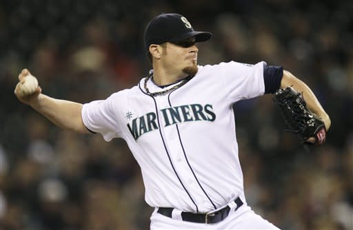 Seattle Mariners starting pitcher Blake Beavan throws in the seventh inning of a baseball game against the Texas Rangers, Saturday, Sept. 22, 2012, in Seattle. (AP Photo/Ted S. Warren)