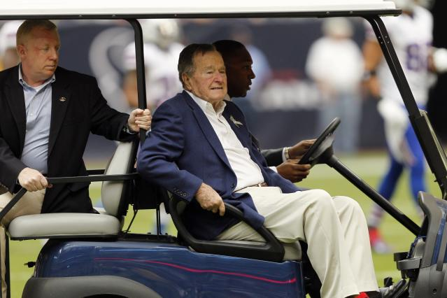 HOUSTON - NOVEMBER 04: Former President George H.W. Bush on hand on Salute To Service day before the Houston Texans play the Buffalo Bills at Reliant Stadium on November 4, 2012 in Houston, Texas. (Photo by Bob Levey/Getty Images)