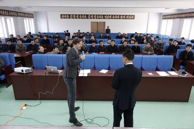 A foreign seminar leader leads a business class in the DPRK.