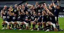 End of a long wait: Scotland celebrate with the Calcutta Cup after beating England 11-6 in the Six Nations