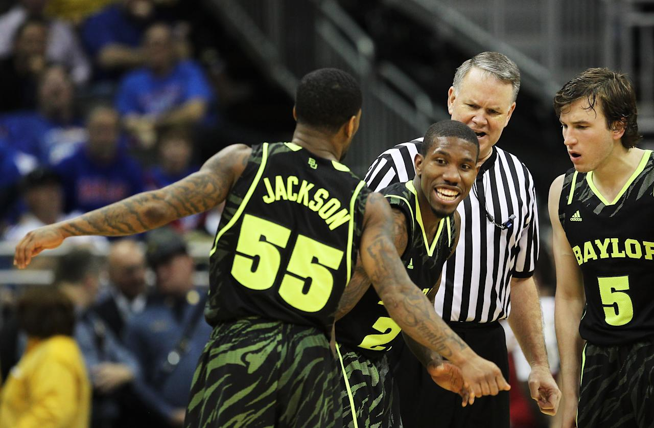 KANSAS CITY, MO - MARCH 09:  Brady Heslip #5, A.J. Walton #22 and Pierre Jackson #55 of the Baylor Bears react in the second half against the Kansas Jayhawks during the semifinals of the 2012 Big 12 Men's Basketball Tournament at Sprint Center on March 9, 2012 in Kansas City, Missouri. The Bears defeated the Jayhawks 81 to 72.  (Photo by Jamie Squire/Getty Images)