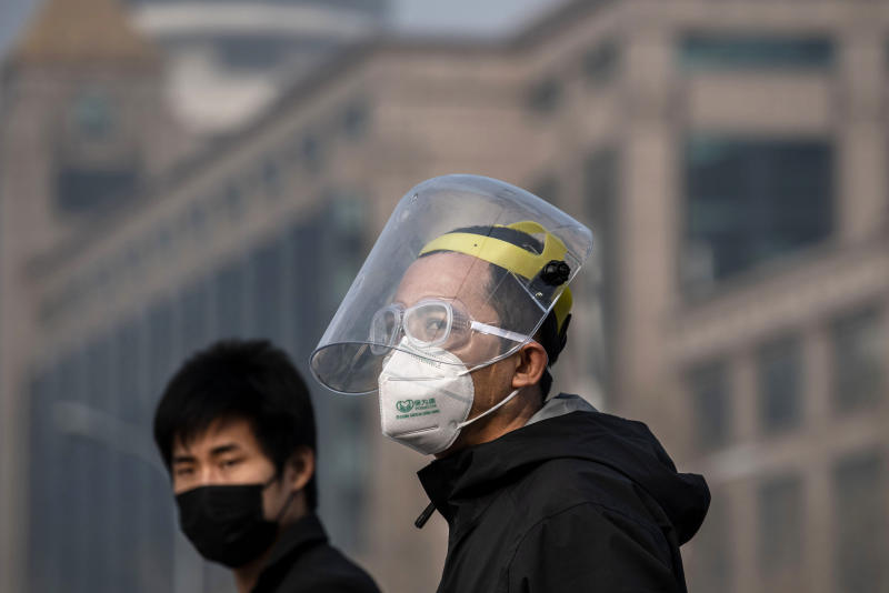 BEIJING, CHINA - FEBRUARY 12: Chinese men wear protective masks as they walk on February 12, 2020 in Beijing, China. The number of cases of a deadly new coronavirus rose to more than 44000 in mainland China Wednesday, days after the World Health Organization (WHO) declared the outbreak a global public health emergency. China continued to lock down the city of Wuhan in an effort to contain the spread of the pneumonia-like disease which medicals experts have confirmed can be passed from human to human. In an unprecedented move, Chinese authorities have put travel restrictions on the city which is the epicentre of the virus and municipalities in other parts of the country affecting tens of millions of people. The number of those who have died from the virus in China climbed to over 1100 on Thursday, mostly in Hubei province, and cases have been reported in other countries including the United States, Canada, Australia, Japan, South Korea, India, the United Kingdom, Germany, France and several others. The World Health Organization has warned all governments to be on alert and screening has been stepped up at airports around the world. Some countries, including the United States, have put restrictions on Chinese travelers entering and advised their citizens against travel to China. (Photo by Kevin Frayer/Getty Images)