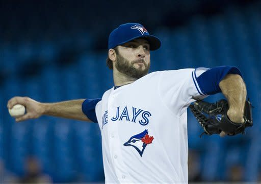 Toronto Blue Jays starting pitcher Brandon Morrow works against the Minnesota Twins during first-inning baseball game action in Toronto, Wednesday, Oct. 3, 2012. (AP Photo/The Canadian Press, Nathan Denette)