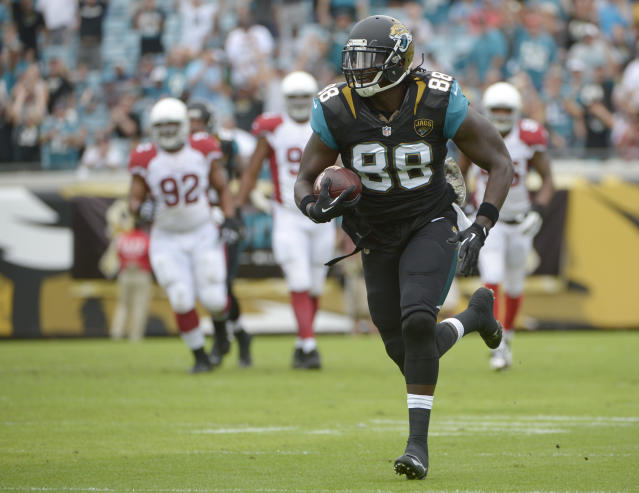 Jacksonville Jaguars tight end Danny Noble (88) outruns the Arizona Cardinals defense to the end zone on a 62-yard touchdown pass during the first half of an NFL football game in Jacksonville, Fla., Sunday, Nov. 17, 2013. (AP Photo/Phelan M. Ebenhack)