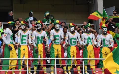 Senegal's supporters cheer their team during the Russia 2018 World Cup Group H football match between Poland and Senegal - Credit: AFP