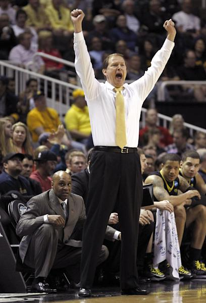FILE - Oregon head coach Dana Altman calls out a play during the second half against Saint Louis in a third-round game in the NCAA college basketball tournament in this March 23, 2013 file photo taken in San Jose, Calif. March 23, 2013 file photo. Oregon is the third school Altman's taken to the NCAA tournament, and the Ducks have had 20-win seasons in each of his three years as head coach. (AP Photo/Tony Avelar, File)