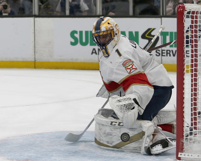 Florida Panthers goaltender Roberto Luongo (1) keeps an eye on the puck as he makes a pad save during the second period of an NHL hockey game against the Boston Bruins, Thursday, March 7, 2019, in Boston. (AP Photo/Mary Schwalm)