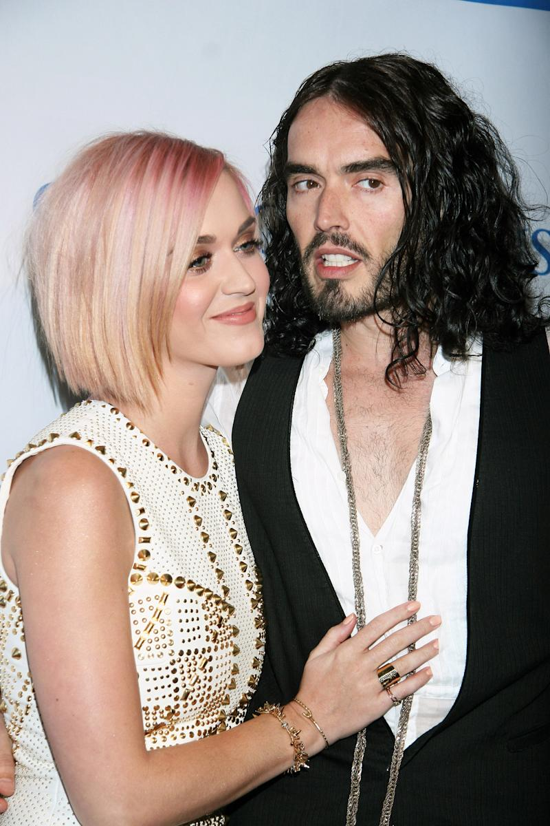 "Katy Perry (L) and actor Russell Brand attend the 3rd annual ""Change Begins Within"" benefit celebration held at the Los Angeles Times Central Court on December 3, 2011 in Los Angeles, California. (Photo by Tommaso Boddi/FilmMagic)"