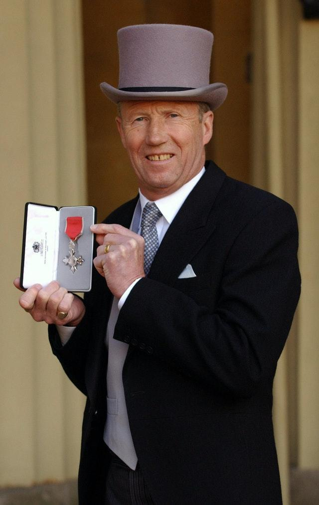 Bell was awarded an MBE for services to the community in 2004