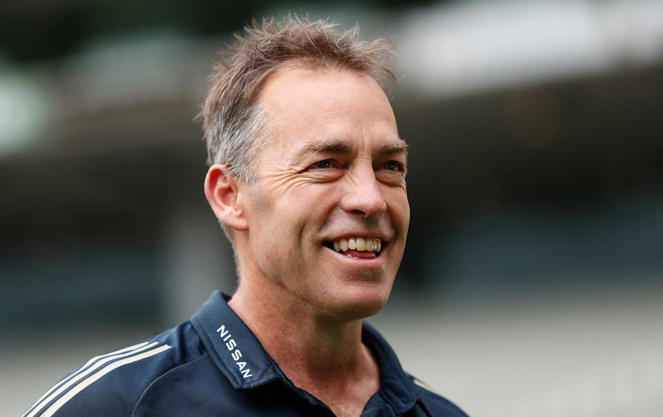 Seen here, former Hawthorn coach Alastair Clarkson smiles during a training session.