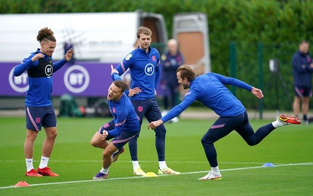 England captain Harry Kane tries to catch Kieran Trippier during an England training session