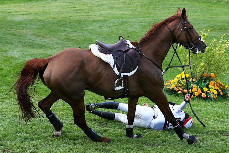 Yoshiaki Oiwa of Japan falls from Noonday de Conde in the Eventing Cross Country Equestrian event on Day 3 of the London 2012 Olympic Games at Greenwich Park on July 30, 2012 in London, England. (Photo by Alex Livesey/Getty Images)