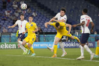 England's Harry Maguire, center top, scores his side's second goal during the Euro 2020 soccer championship quarterfinal match between Ukraine and England at the Olympic stadium in Rome at the Olympic stadium in Rome, Italy, Saturday, July 3, 2021. (AP Photo/Alessandra Tarantino, Pool)