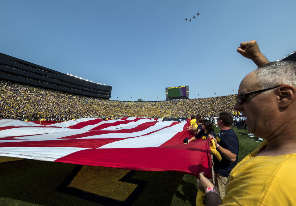 Four U.S. Air Force T-38 jets fly over Michigan Stadium before the Michigan-Air Force game on Sept. 16. (AP)