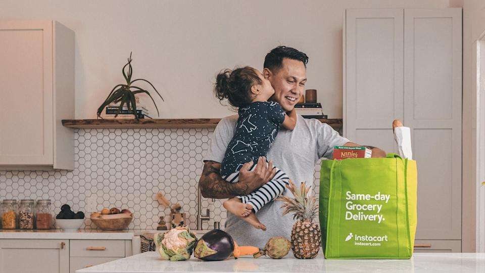 dad and child unpacking groceries - Instacart