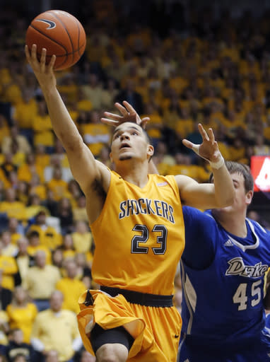Wichita State's Fred VanVleet goes to the basket against Drake's Seth VanDeest during an NCAA basketball game, Saturday, Feb. 22, 2014 in Wichita, Kan. (AP Photo/The Wichita Eagle, Travis Heying)