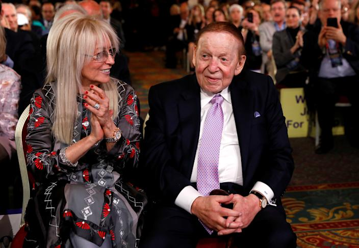 Casino magnate Sheldon Adelson and his wife Miriam listen to U.S. President Donald Trump address the Republican Jewish Coalition 2019 Annual Leadership Meeting in Las Vegas, Nevada, U.S., April 6, 2019.  REUTERS/Kevin Lamarque