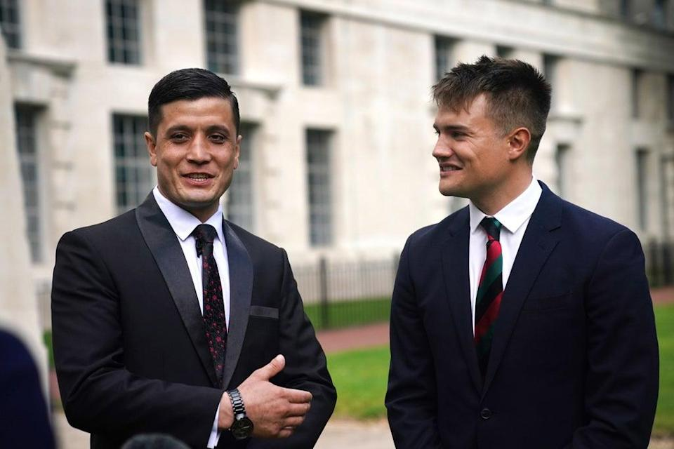 Afghan special operations officer First Lieutenant Mohammad Jawad Akbari, left, and British Army officer Captain Dave Kellett talk to each other by the Iraq Afghanistan Memorial at the Ministry of Defence building in Westminster, central London (Victoria Jones/PA) (PA Wire)