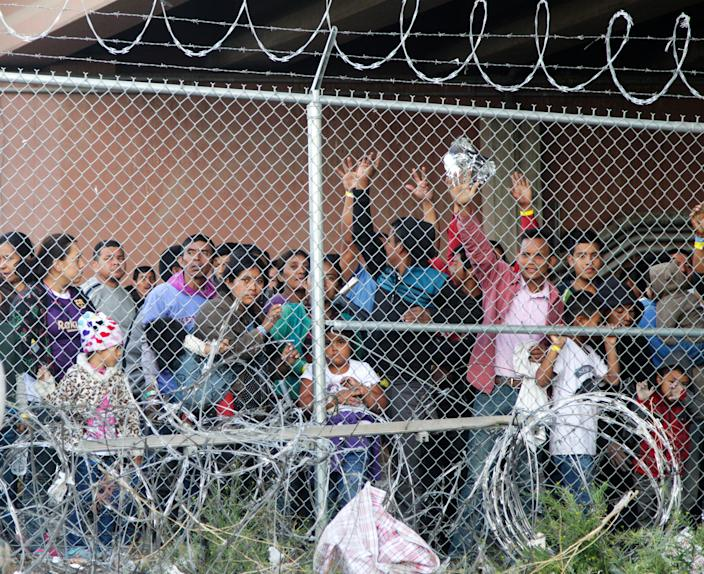 Central American migrants wait for food in a pen erected by U.S. Customs and Border Protection to process a surge of families and unaccompanied minors in El Paso, Texas, in March 2019.