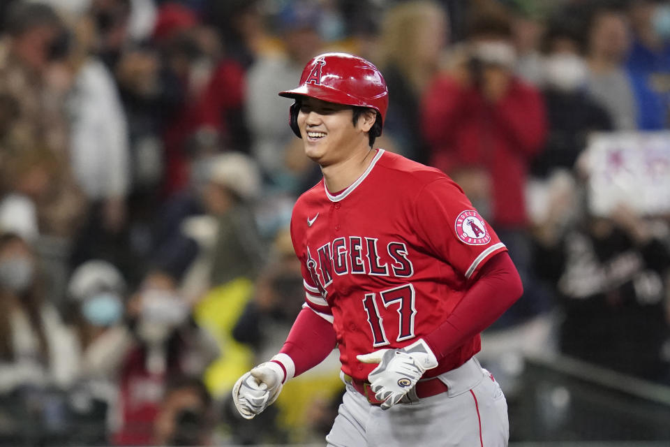 Los Angeles Angels' Shohei Ohtani heads home on his solo home run against the Seattle Mariners in the first inning of a baseball game Sunday, Oct. 3, 2021, in Seattle. (AP Photo/Elaine Thompson)