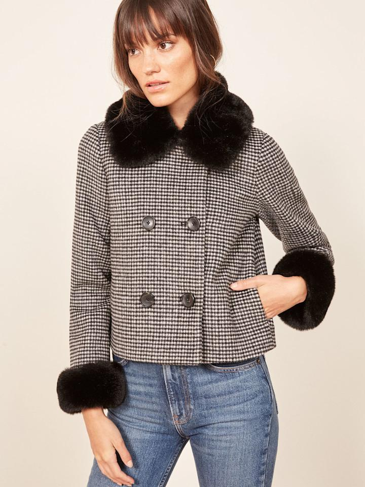 """<p>From the fur trim to classic houndstooth print, what isn't there to love about this chic <a rel=""""nofollow"""" href=""""https://www.popsugar.com/buy/Reformation-Templeton-Coat-365787?p_name=Reformation%20Templeton%20Coat&retailer=thereformation.com&price=228&evar1=fab%3Aus&evar9=45279703&evar98=https%3A%2F%2Fwww.popsugar.com%2Ffashion%2Fphoto-gallery%2F45279703%2Fimage%2F45279846%2FReformation-Templeton-Coat&list1=shopping%2Cfall%20fashion%2Cfall%2Ceditors%20picks%2Ceditors%20picks&prop13=mobile&pdata=1"""" rel=""""nofollow"""">Reformation Templeton Coat</a> ($228)?</p>"""
