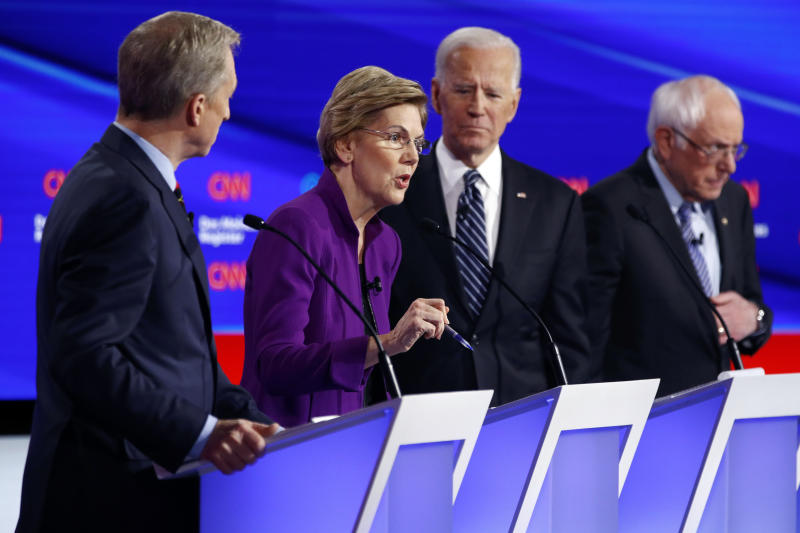 Democratic presidential candidate Sen. Elizabeth Warren, D-Mass., second from left, speaks as fellow candidates businessman Tom Steyer, left, former Vice President Joe Biden and Sen. Bernie Sanders, I-Vt., right, listen, Tuesday, Jan. 14, 2020, during a Democratic presidential primary debate hosted by CNN and the Des Moines Register in Des Moines, Iowa. (AP Photo/Patrick Semansky)