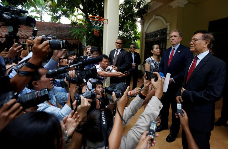 FILE PHOTO: Leader of the Cambodia National Rescue Party (CNRP) Kem Sokha and U.S Ambassador to Cambodia Patrick Murphy listen a question after a meeting in Phnom Penh