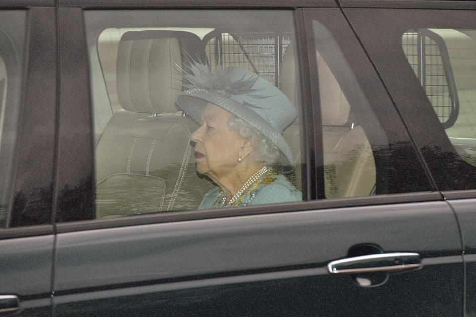 Britain's Queen Elizabeth II travels in a Range Rover to the Houses of Parliament for the State Opening of Parliament in London on May 11, 2021, which is taking place with a reduced capacity due to Covid-19 restrictions. - The State Opening of Parliament is where Queen Elizabeth II performs her ceremonial duty of informing parliament about the government's agenda for the coming year in a Queen's Speech. (Photo by JUSTIN TALLIS / AFP) (Photo by JUSTIN TALLIS/AFP via Getty Images)