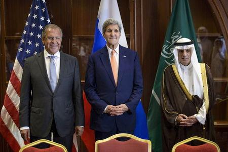Russia's Foreign Minister Sergey Lavrov, U.S. Secretary of State John Kerry and Saudi Arabia's Foreign Minister Adel al-Jubeir stand together before a trilateral meeting in Doha, Qatar