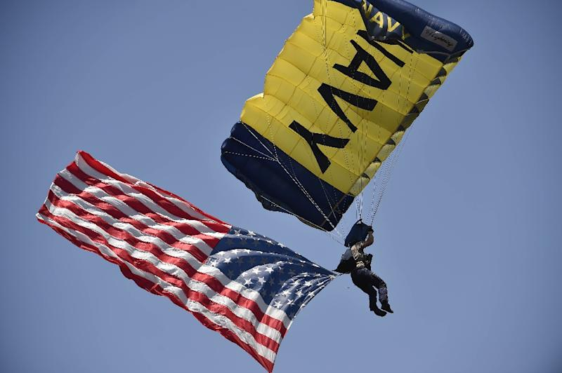 A member of the Navy Seals Leapfrogs parachute team lands on the field before a baseball game at Petco Park  in San Diego, California
