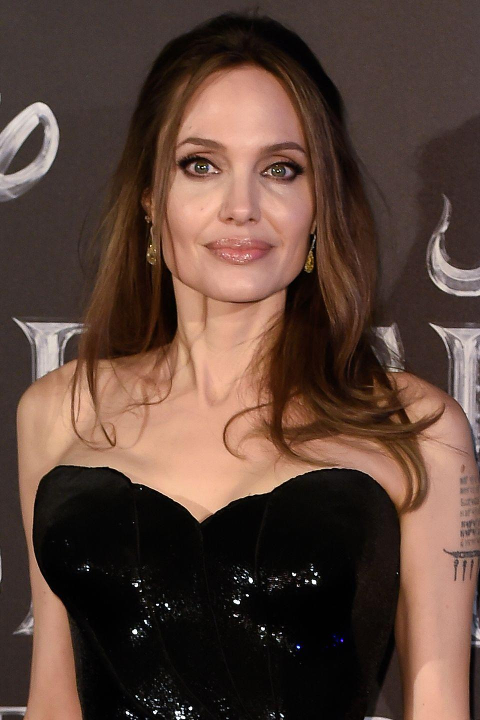 <p>Like a true bombshell, Jolie's waves are perfectly voluminous and messy, yet still chic enough to wear on the red carpet.</p>