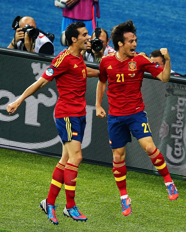 KIEV, UKRAINE - JULY 01: David Silva (R) of Spain celebrates with team-mate Alvaro Arbeloa after scoring the opening goal during the UEFA EURO 2012 final match between Spain and Italy at the Olympic Stadium on July 1, 2012 in Kiev, Ukraine. (Photo by Martin Rose/Getty Images)