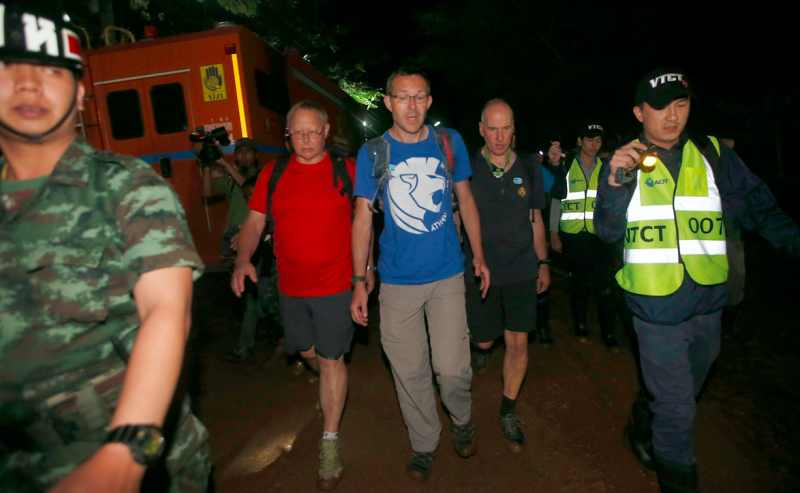 British Cave Rescue Council members from second left, Robert Charles Harper , John Volanthen and Richard William arrive at the cave before their successful search for the boys (Picture: PA)