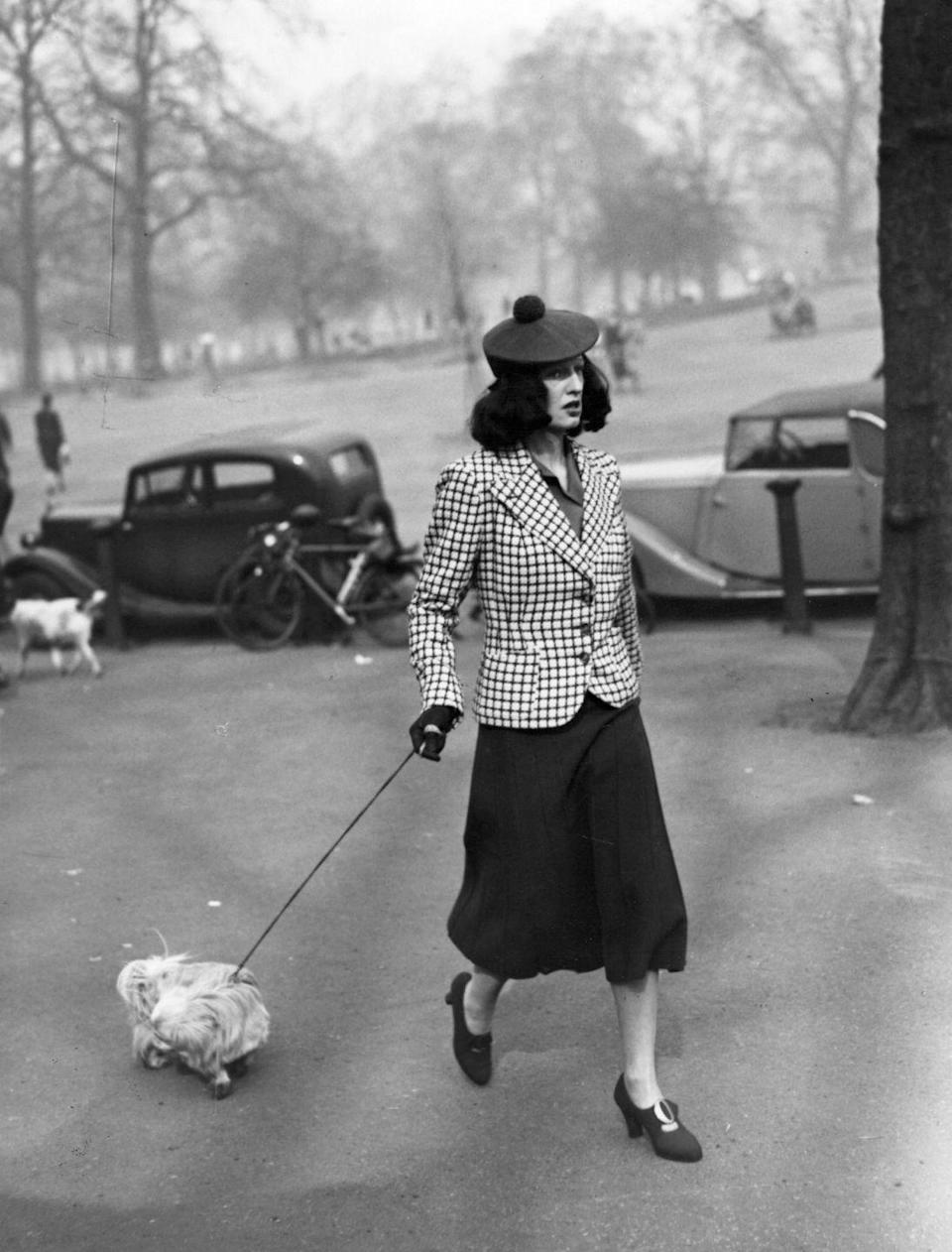 <p>Accessories clearly take the reign here, see: the pom pom beret and heeled loafers. And we're happy to report that cute dogs are still a trend. </p>