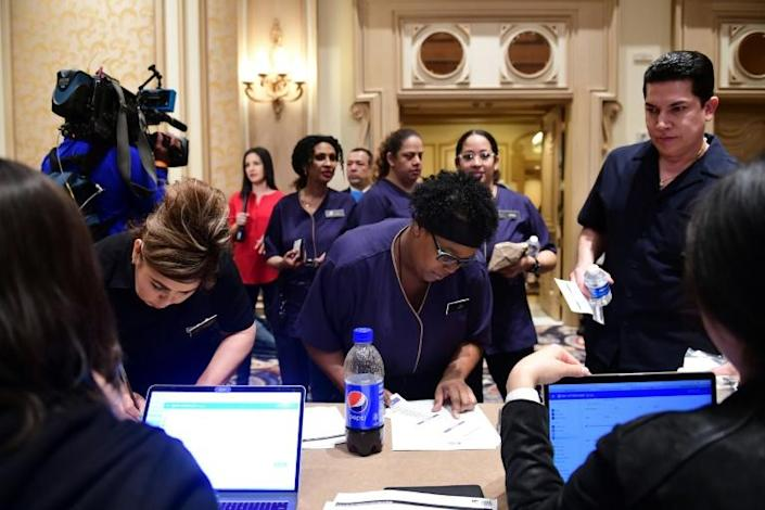 Workers at Las Vegas's luxurious Bellagio Hotel check in before taking part in the Democratic presidential caucus on February 22, 2020, an exercise they described as 'chaotic' but 'fun' (AFP Photo/FREDERIC J. BROWN)