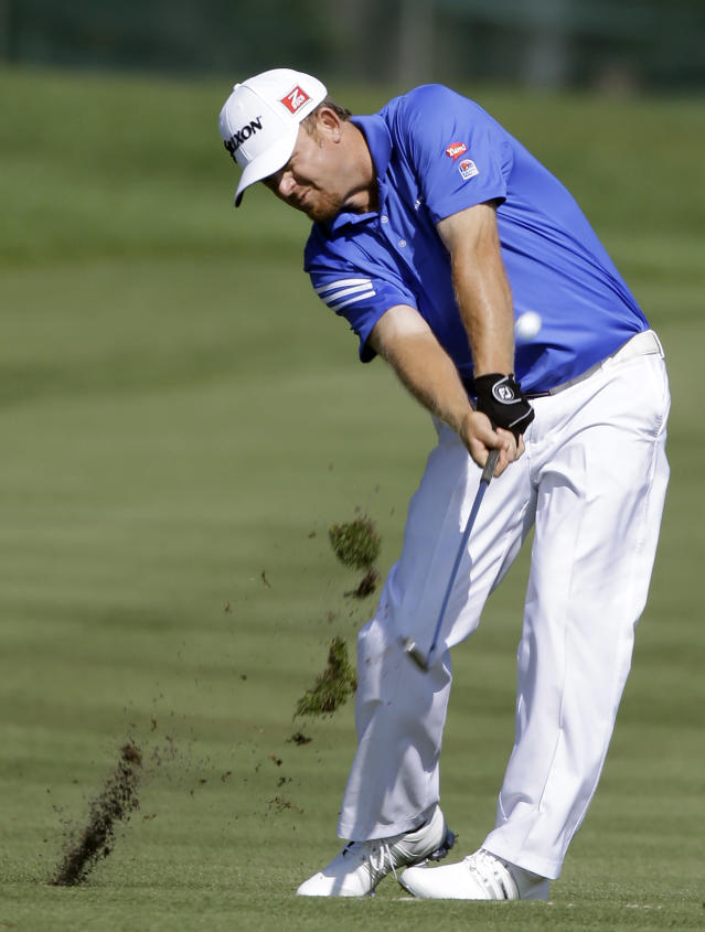 J.B. Holmes hits his second shot on the fifth fairway during the second round of the Arnold Palmer Invitational golf tournament at Bay Hill Friday, March 21, 2014, in Orlando, Fla. (AP Photo/Chris O'Meara)