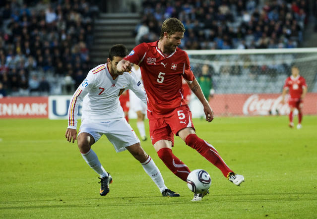 Swiss's Jonathan Rossini (R) vies with Spain's Adrian Lopez during the UEFA Under-21 European Championship final football match Spain vs Switzerland at the Aarhus Stadium, on June 25, 2011. AFP PHOTO/JONATHAN NACKSTRAND (Photo credit should read JONATHAN NACKSTRAND/AFP/Getty Images)
