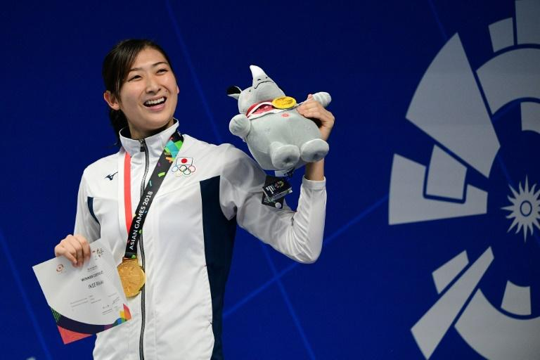 Poster girl: Rikako Ikee celebrates her 50m freestyle gold at the Asian Games in Jakarta in August. Ikee, 18, says she is determined to beat leukaemia