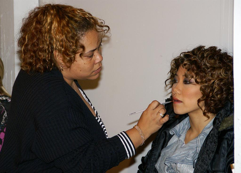 Cindy Minowa (20), one of the fierce females from Kaba Modern, is touched up by one of MTV's makeup artists. Ladies, I'm loving the lips, but I'm thinking the hairdo is actually a hairdon't.