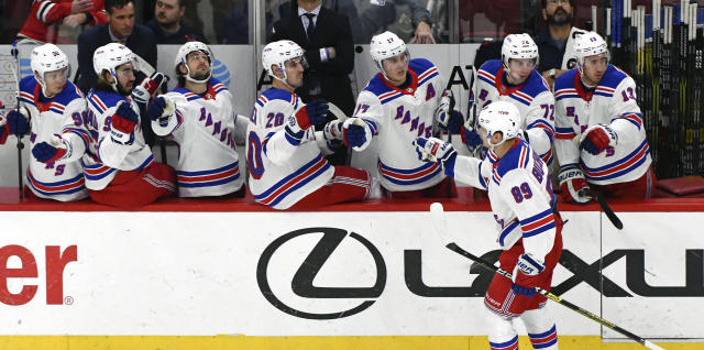 New York Rangers right wing Pavel Buchnevich (89) celebrates his goal against the Chicago Blackhawks with teammates during the first period of an NHL hockey game on Thursday, Oct. 25, 2018, in Chicago. (AP Photo/Matt Marton)