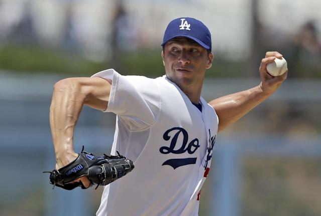 Los Angeles Dodgers starter Chris Capuano pitches to the Cincinnati Redsin the first inning of a baseball game in Los Angeles, Sunday, July 28, 2013. (AP Photo/Reed Saxon)