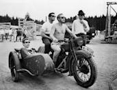 <p>Steve McQueen helms the wheel of a motorcycle with James Coburn in the sidecar on November 1st, 1962.</p>