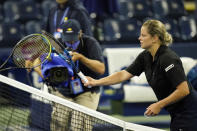 Kim Clijsters, of Belgium, taps racquets with Ekaterina Alexandrova, of Russia, after loosing her match during the first round of the U.S. Open tennis championships, Tuesday, Sept. 1, 2020, in New York. (AP Photo/Frank Franklin II)