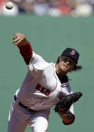Boston Red Sox starting pitcher Clay Buchholz (11) delivers to the Baltimore Orioles during the first inning of a baseball game at Fenway Park in Boston, Monday, April 8, 2013. (AP Photo/Elise Amendola)