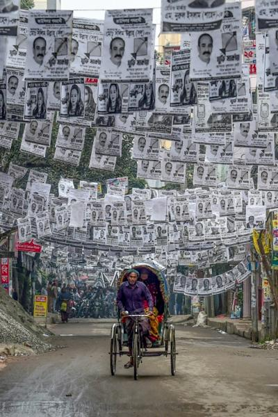 Dhaka's estimated 304 million election posters will likely end up in sewers, rivers and canals, says activist Sharif Jamil (AFP Photo/Munir UZ ZAMAN)
