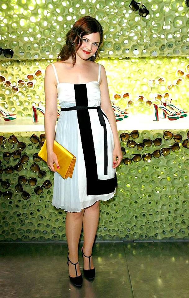 "The adorable Ginnifer Goodwin (""Big Love"") adds a punch of color to her black and white outfit with a yellow clutch. Donato Sardella/<a href=""http://www.wireimage.com"" target=""new"">WireImage.com</a> - March 19, 2008"