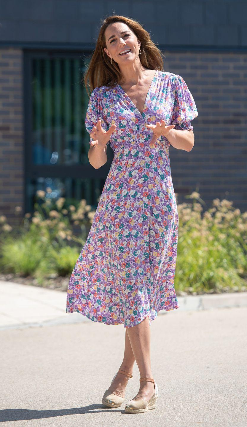<p>Kate Middleton picked this flowing dress in a pastel color palette and espadrille wedges to visit The Nook, a hospice facility for children, in June 2020. </p>