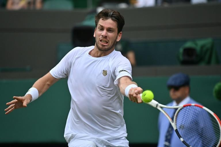 """Britain's Cameron Norrie has played Federer in singles once before -- """"He absolutely whacked me"""" (6-1, 6-1) -- and recalls the surreal atmosphere at the 2018 Hopman Cup"""